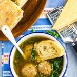 Overhead picture of Italian wedding soup served with bread.