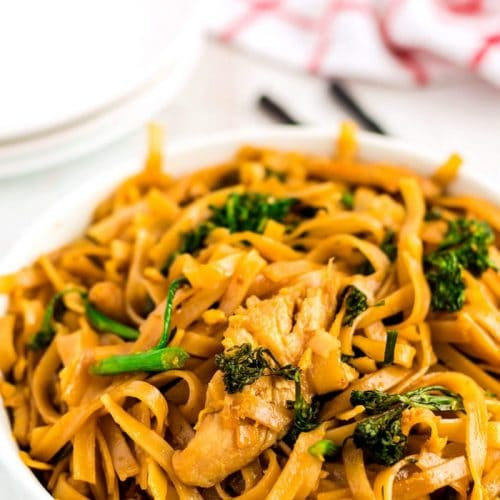 Rice noodles with chicken, broccoli, egg, and a sweet and savory sauce.