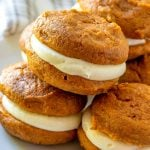 A close up picture of a stack of pumpkin whoopie pies.