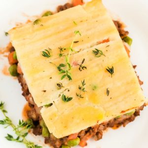 A close up and overhead picture of a slice of classic shepherd's pie.