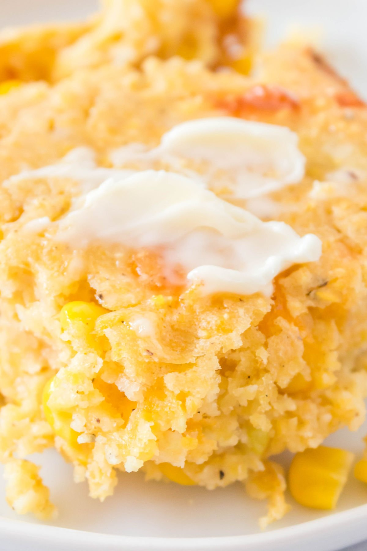 Easy Cornbread Casserole with Cheese is a comforting side dish for entertaining and busy weeknights! It's quick to whip together and so delicious! via @foodfolksandfun