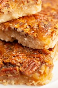 A close up of the inside of a pecan pie bar.