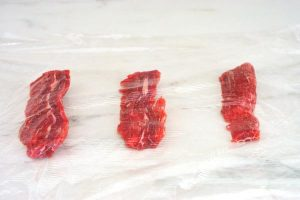 Place the meat between pieces of plastic wrap.