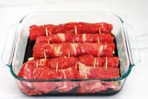 Place the rolls in a baking dish and pour the sauce over it.