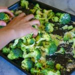 Place the broccoli on a baking sheet and mix with olive oil, lemon zest, and salt and pepper.