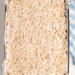 Pour the Rice Krispies mixture into the prepared pan and press the treats into the pan using wax paper.