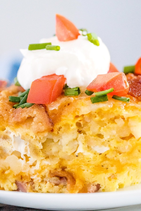A close up slice of tater tot breakfast casserole.