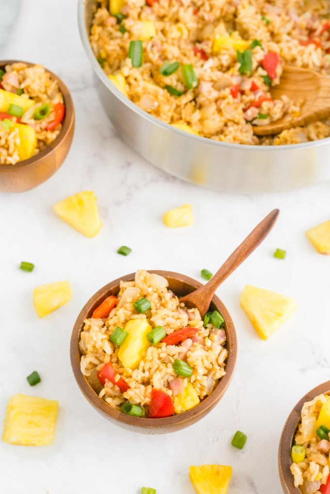 Put those holiday ham leftovers to good use by making this Hawaiian Fried Rice recipe. It's quick, easy, and SO delicious! via @foodfolksandfun