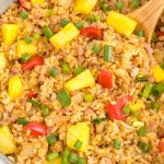 A close up picture of Hawaiian fried rice in a large skillet.