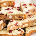 A pile of Cranberry Bliss Bars on a white platter.