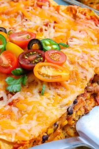 A close up picture of the baked chicken enchilada casserole.