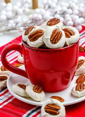 A red mug filled with divinity candy.