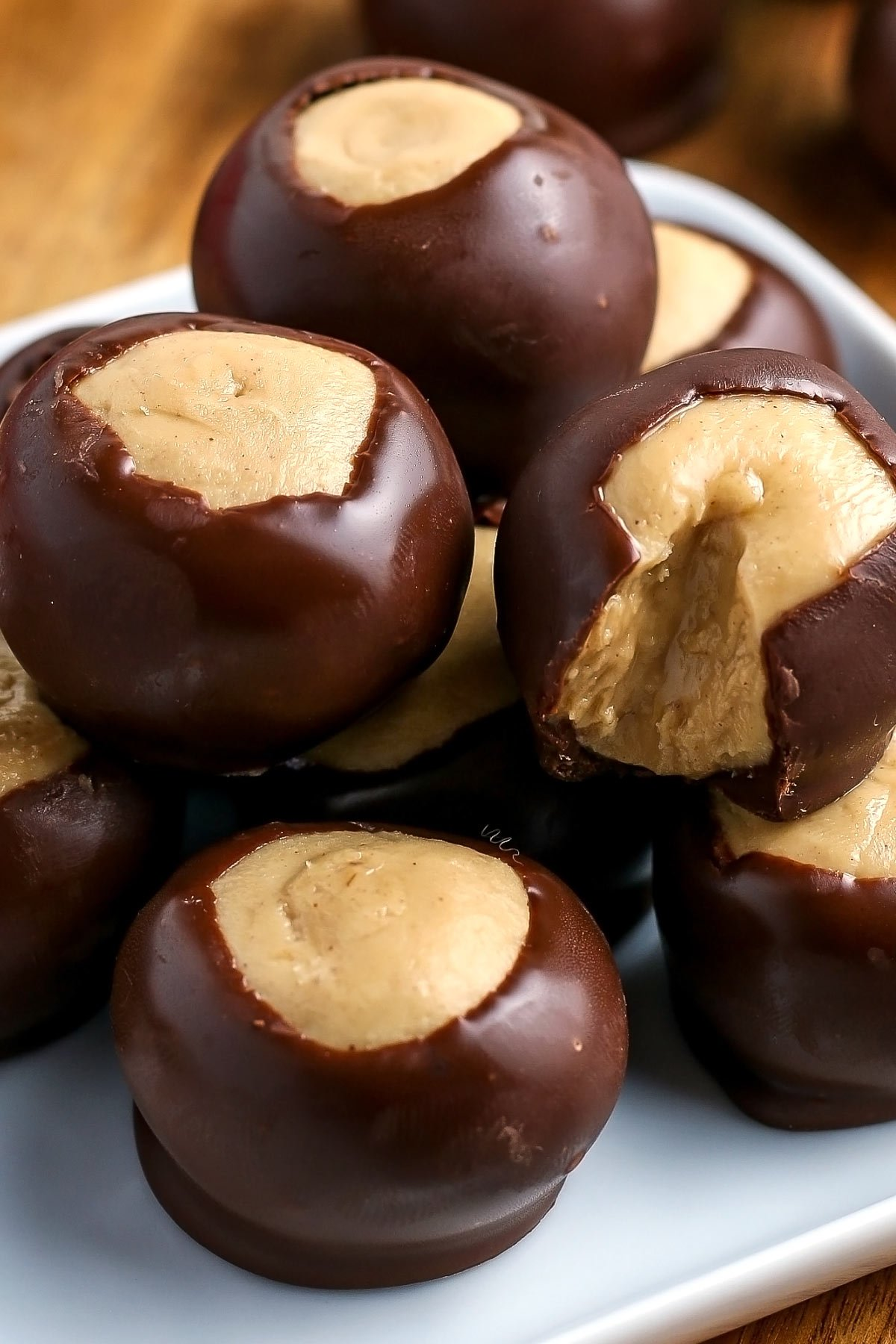 Buckeye Candy has a peanut butter fudge center, and they're partially dipped in chocolate. Buckeyes are easy to make and require just six ingredients.  via @foodfolksandfun