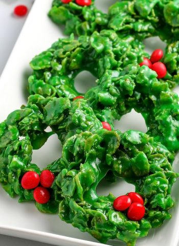 Rows of Christmas Wreath Cookies on a white serving dish.