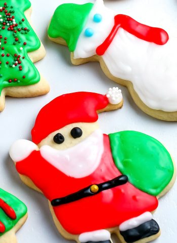 A close up picture of cut out sugar cookies decorated with icing.