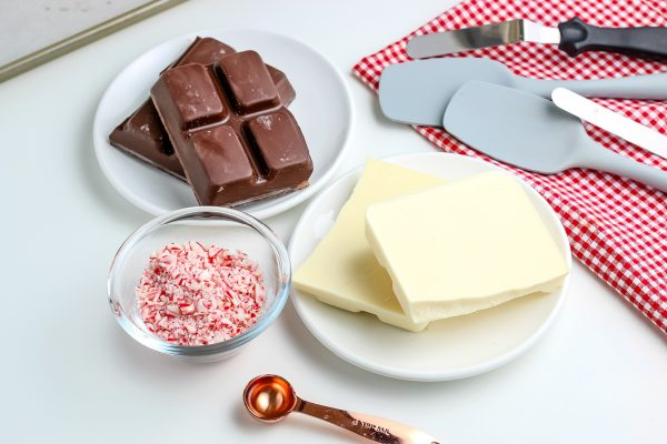 All of the ingredients needed to make peppermint bark candy.