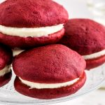 A close up picture of 3 whoopie pies stacked on each other.