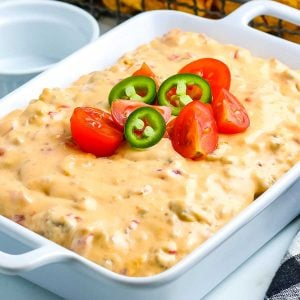 Rotel Cheese Dip in a white serving dish.