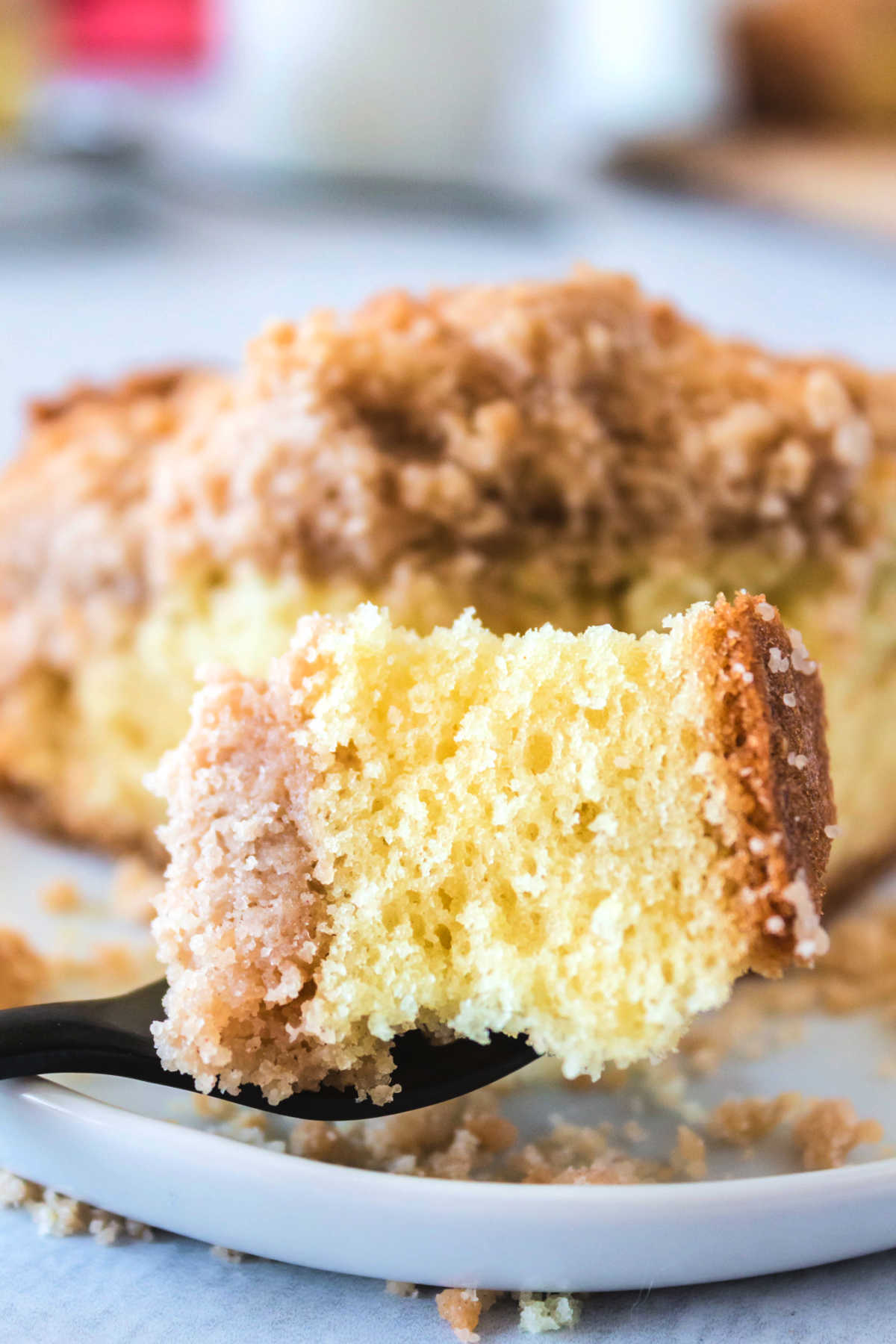 This Cinnamon Crumb Cake recipe is a breakfast classic. It has a rich, buttery, and tender cake crumb and a cinnamon crumb topping that is irresistible. via @foodfolksandfun