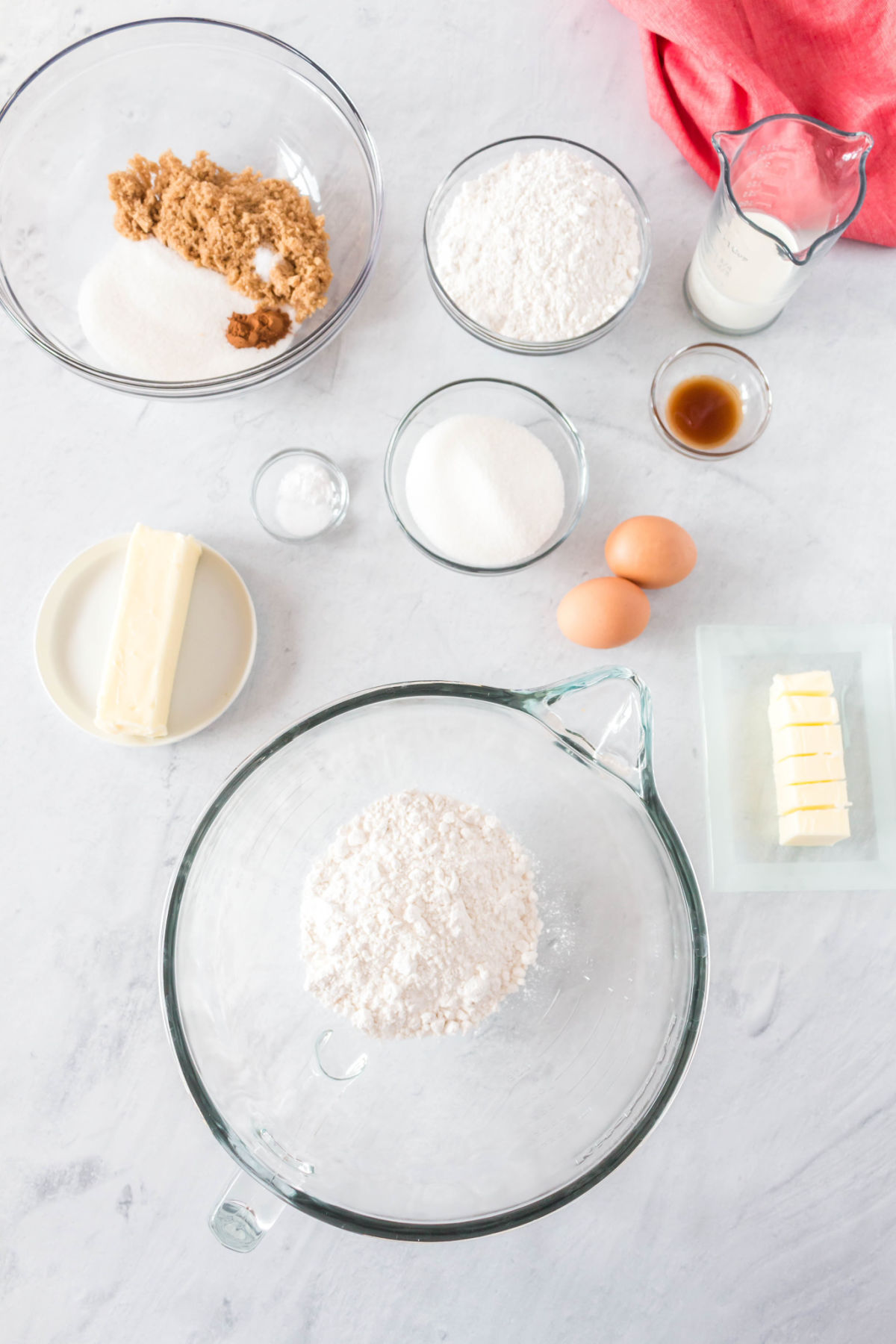 An overhead picture of all of the ingredients needed to make crumb cake.