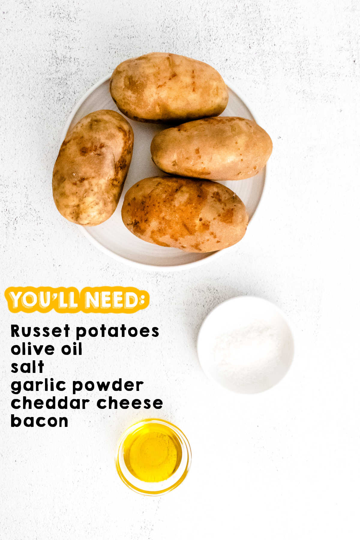 An over head picture of the ingredients needed to make potato skins.