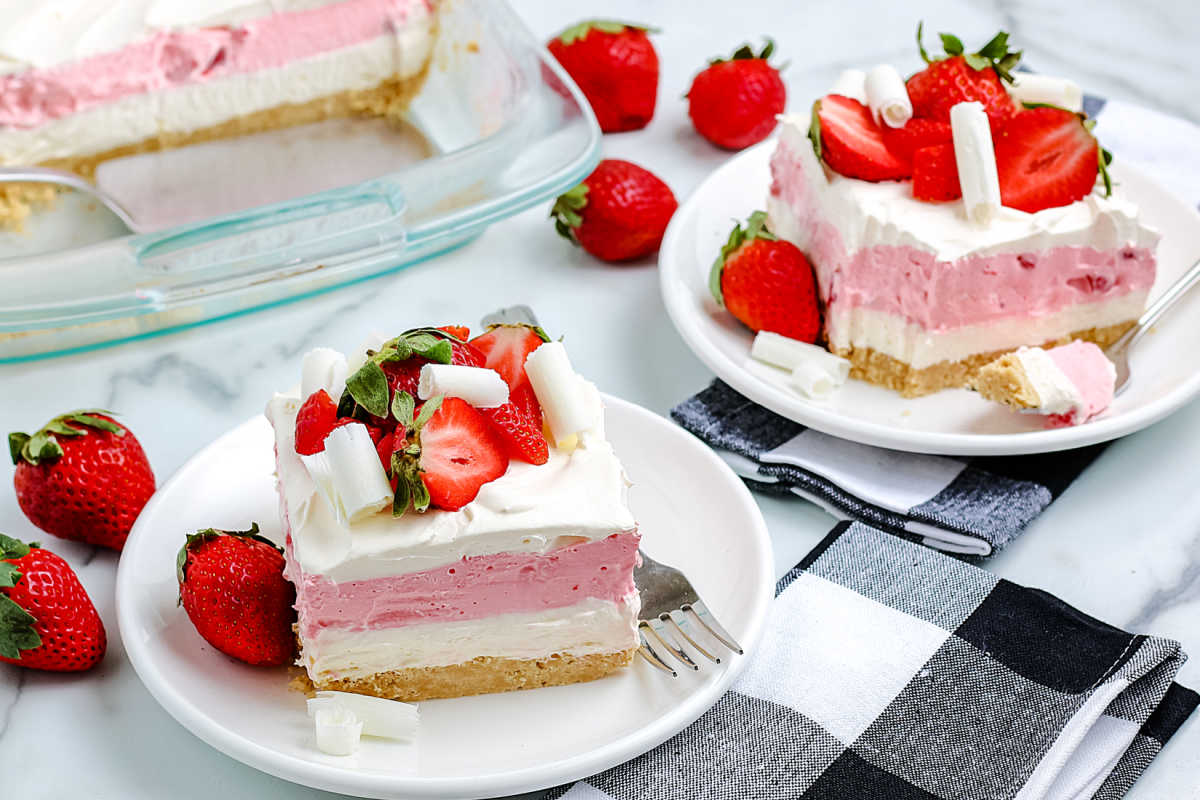 Two slices of Strawberry Lasagna on white plates.