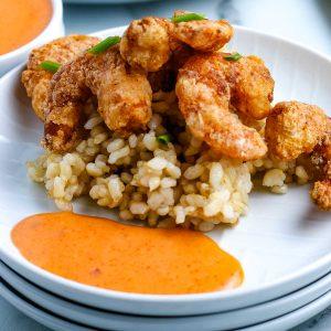 Bang Bang Shrimp Recipe with Bang Bang Shrimp Sauce on a white plate.