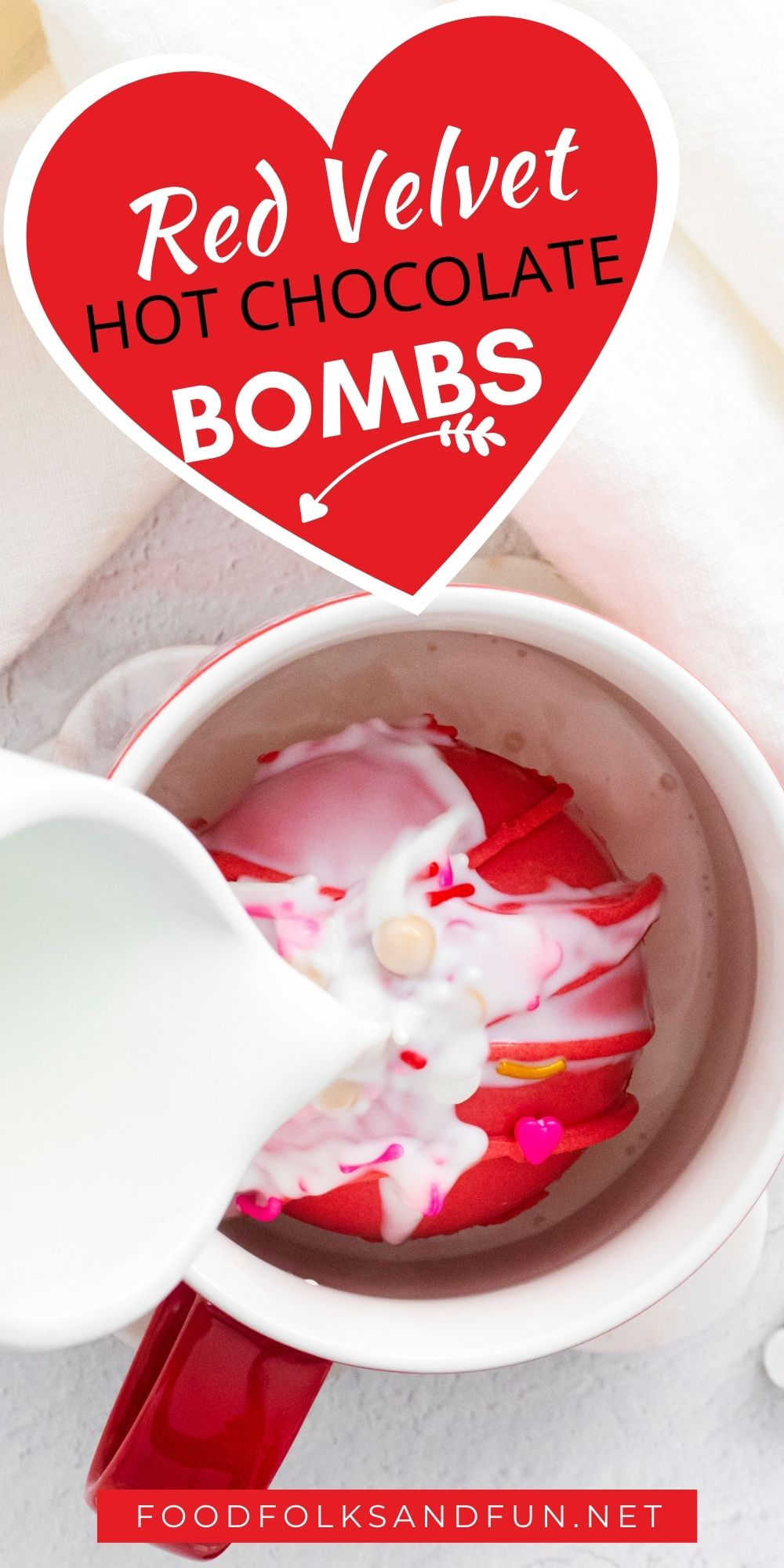 These Red Velvet Hot Chocolate Bombs are white chocolate spheres filled with hot cocoa mix, chocolate shards, and mini marshmallows. Now tell me that doesn't sound delicious! These are perfect for holidays and gifting. via @foodfolksandfun