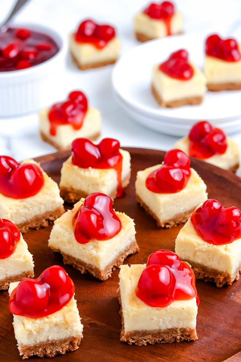 The finished Cheesecake Bars on a wooden platter.