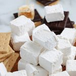 Homemade marshmallows stacked on top of each other.