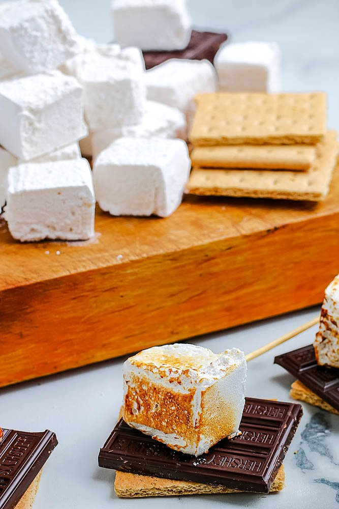 Toasted homemade marshmallows served as s'mores.