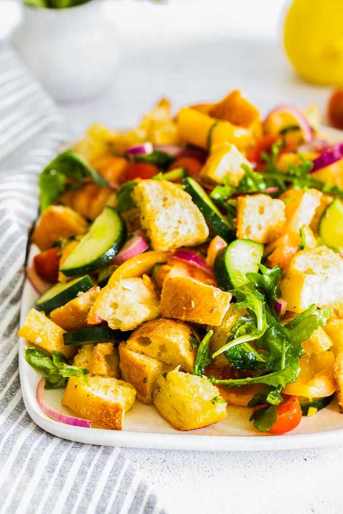 A close up picture of Panzanella Salad on a serving platter.