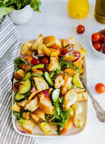 The finished Panzanella Salad on a white platter.