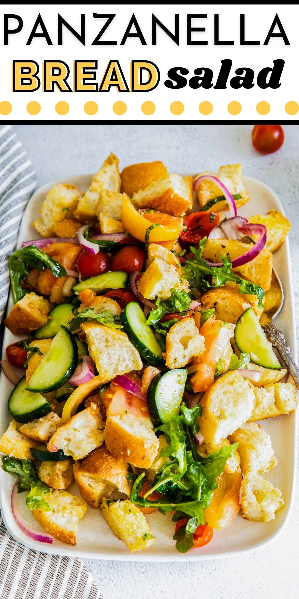 This Panzanella Salad is a bread salad made with ciabatta bread, arugula, cucumber, tomatoes, red onion, basil, capers, and an easy homemade vinaigrette. via @foodfolksandfun