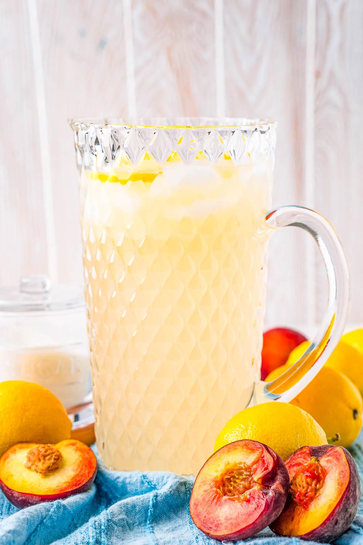A glass pitcher of Peach Lemonade.