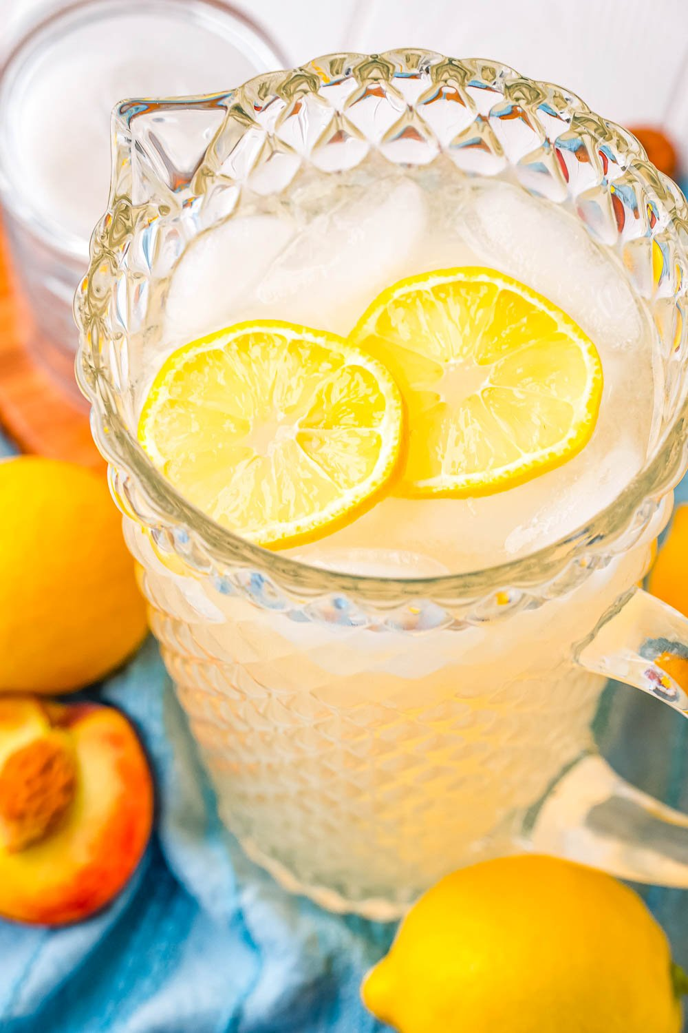 An overhead picture of a glass pitcher filled with Peach Lemonade.