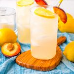 Peach Lemonade on a wooden tray.