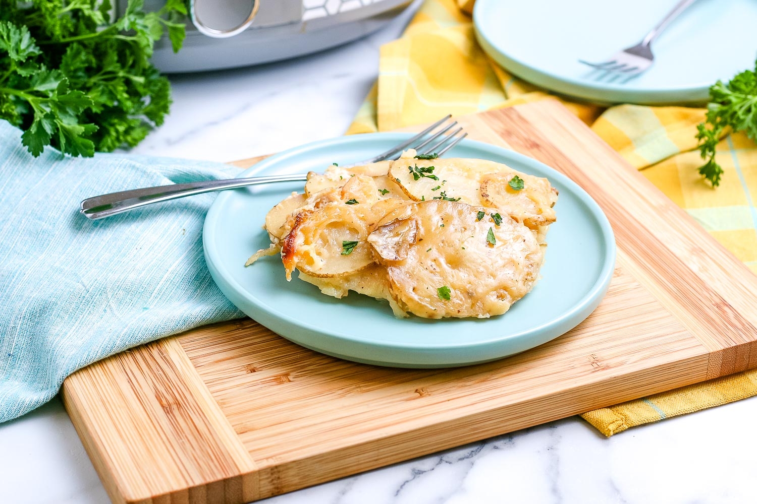 Scalloped Potatoes on a blue plate.