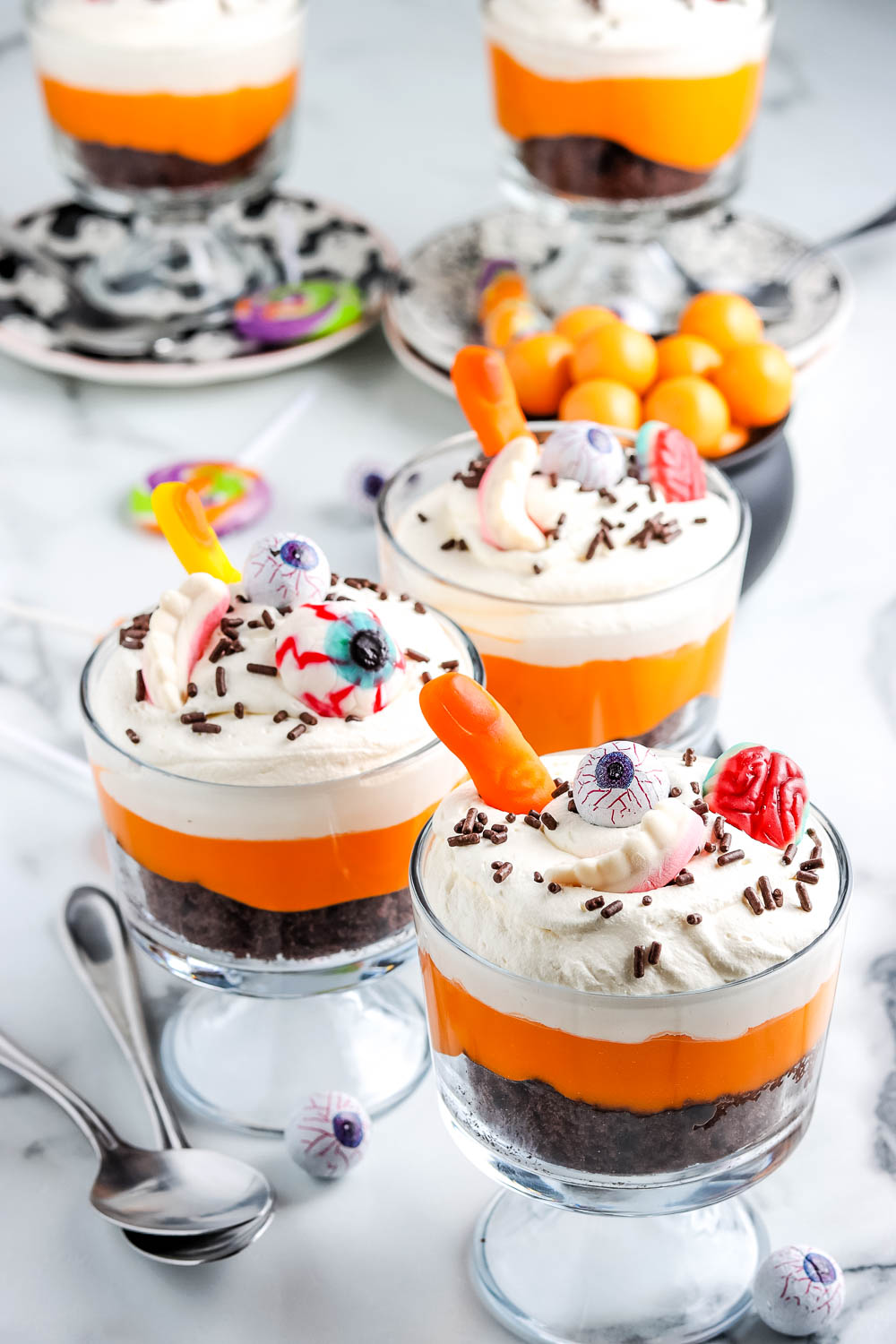 Chocolate trifles decorated with Halloween candies.