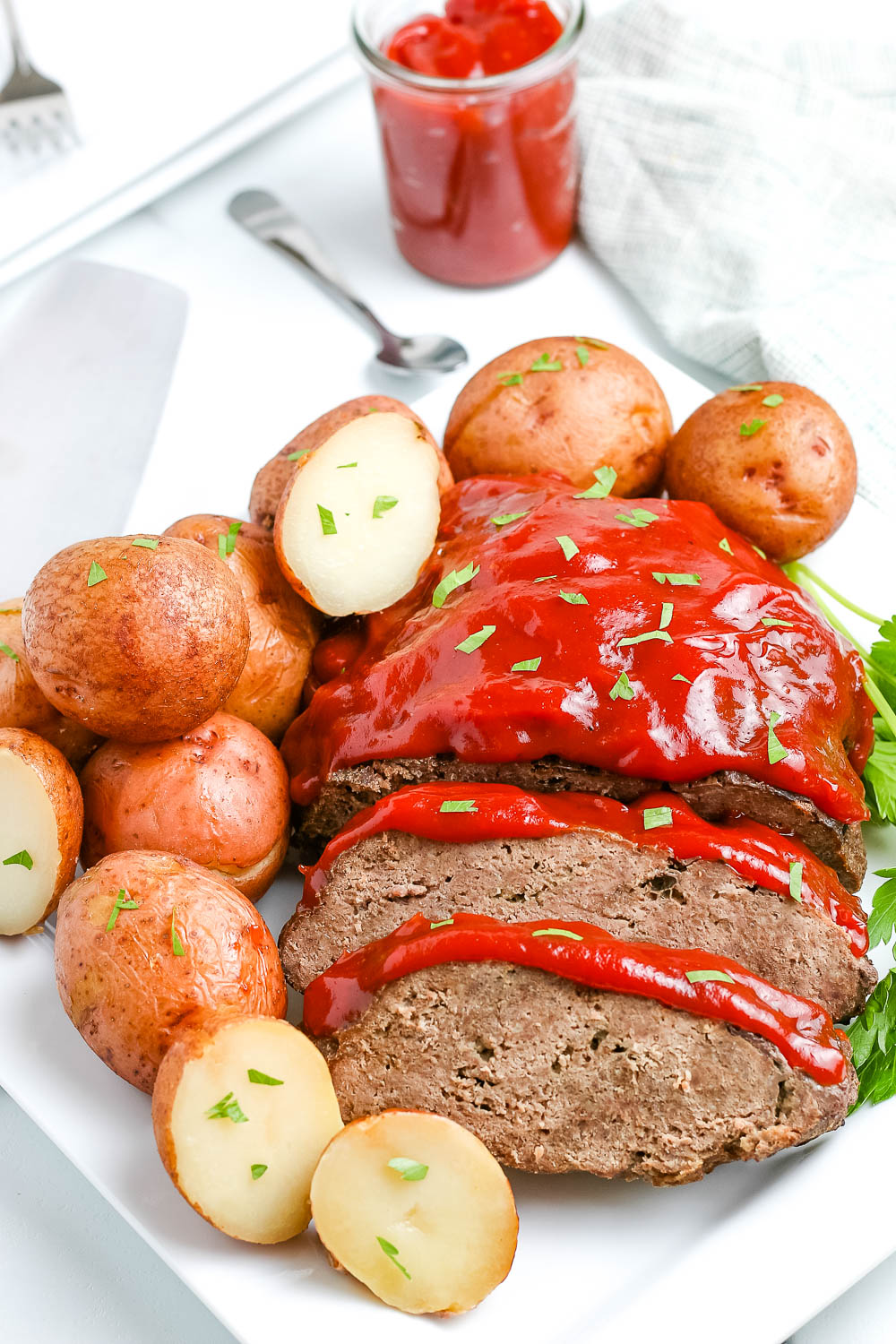 The finished Instant Pot Meatloaf with potatoes on a serving platter.