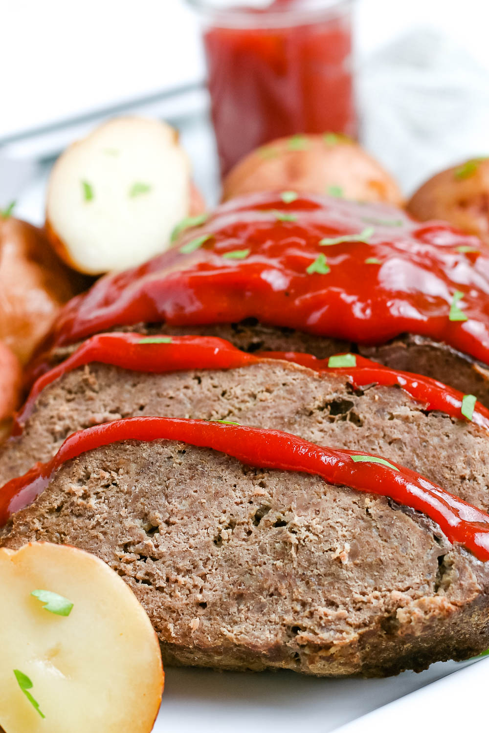 A close up picture of the finished Instant Pot Meatloaf on a serving platter.