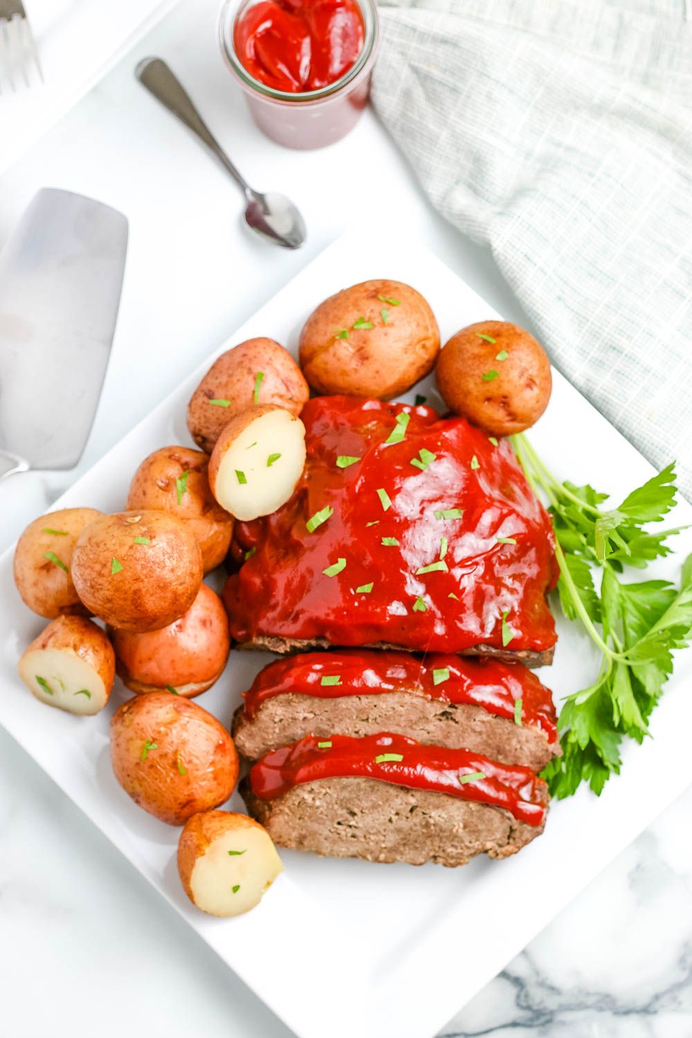 An overhead picture of the finished Instant Pot Meatloaf on a white serving platter.