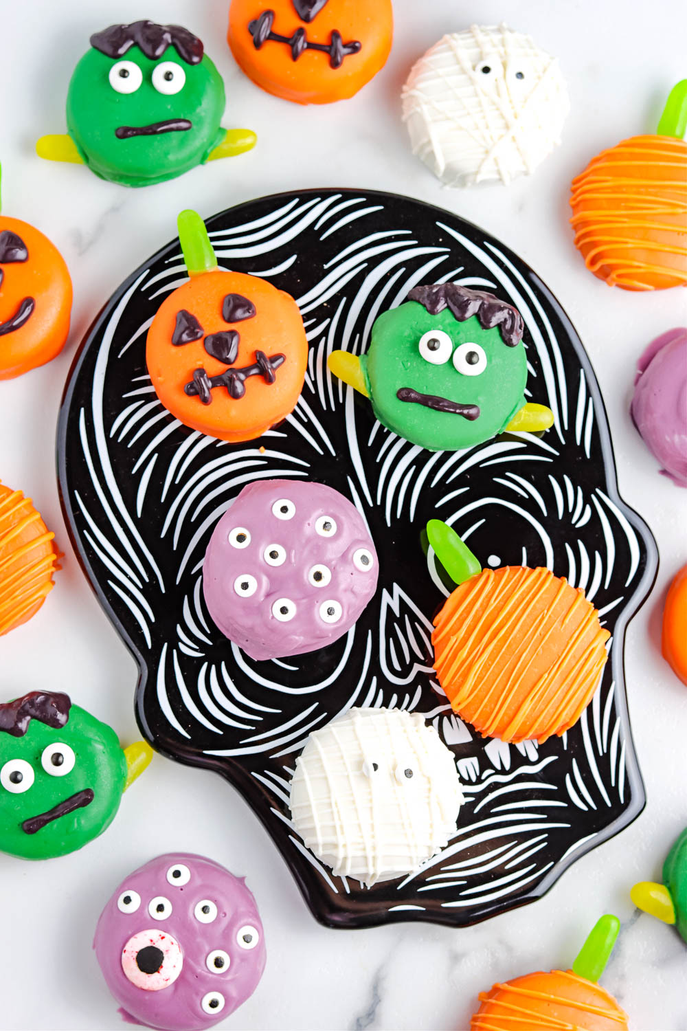 The finished Chocolate Dipped Oreos on a black Halloween platter.